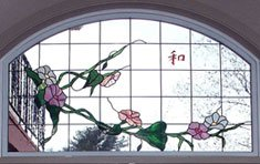Japanese Dogwood with Harmony Symbol Painted on Transom Glass | Custom designed and installed into a Therma-Tru set of double doors with transom
