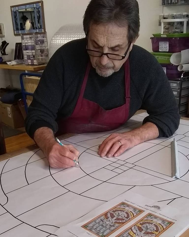 Ivy Pompei hand crafting a stained glass window for a custom order