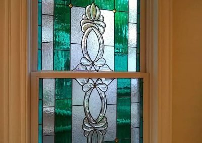 Andersen double hung window with stained glass